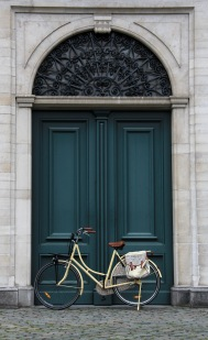 Classic picture of a bike leaning against the door of the Cathedral of Our Lady Antwerp.