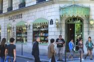 Busy macaron shop in Paris on Avenue des Champs-Élysées //August 2013