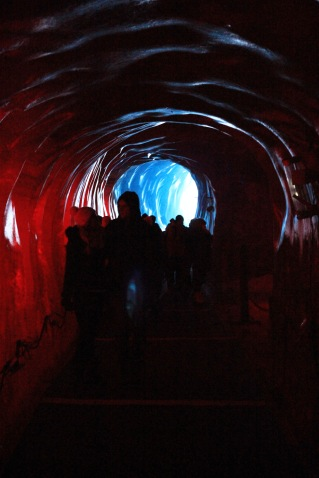 The ice caves in Chamonix lit up with lights.